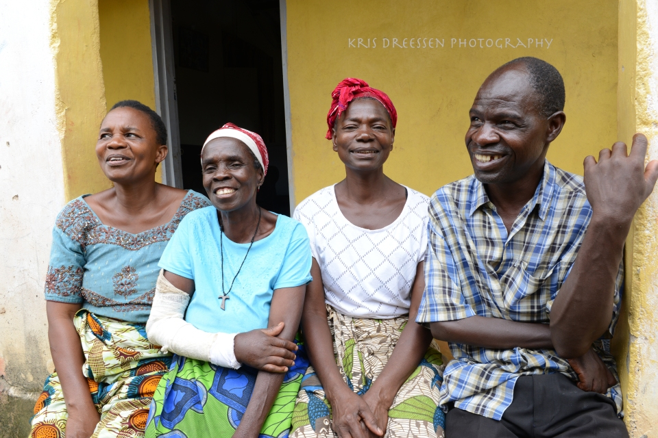 Margaret Nsombo, left, with some of the neighbors she and her friends help.